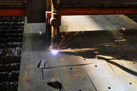 laser cutting torch machine in an industrial plant cuts sheet metal. Industry Imagens