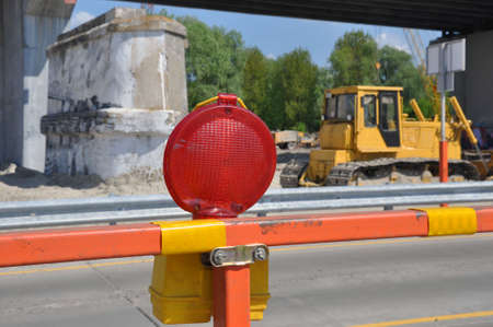 Bridge repair. Warning signs for work in progress on road under construction.