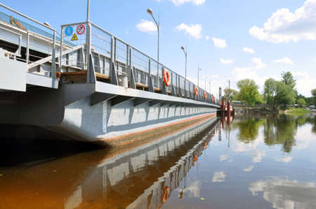 Repair of the bridge over the Pina River in Pinsk, Belarus. Movement of cars in time
