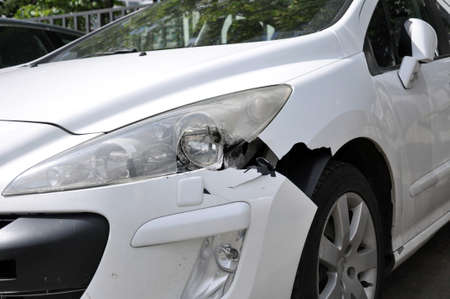 The consequence of a car accident. Damaged bumper and head optics. Security