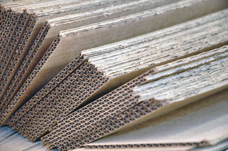 Corrugated cardboard sheets one by one, they are prepared for packing metal structures. Cardboard printing background