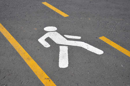 Crosswalk. Road marking in the form of a human figure