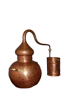 Alembic Copper - Distillation apparatus employed for the distillation of alcohol, essential oils and moonshine. Modern wine distillery for the home made of the wine isolated on white.