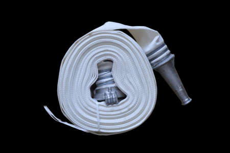 White rolled up fire extinguishing hose with coupling and nozzle, isolated