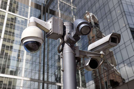 closed circuit camera Multi-angle CCTV system against the backdrop of a modern city. Security. 版權商用圖片