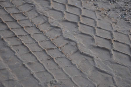 Traces of the tread of a truck lorry on a dirt surface. Criminal identification