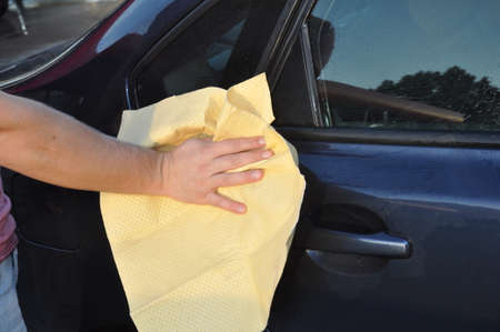 A man cleaning car with microfiber cloth, car detailing. concept