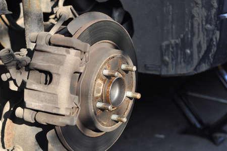 Car brake disc with brake caliper with the wheel removed. Wheel hub Banco de Imagens