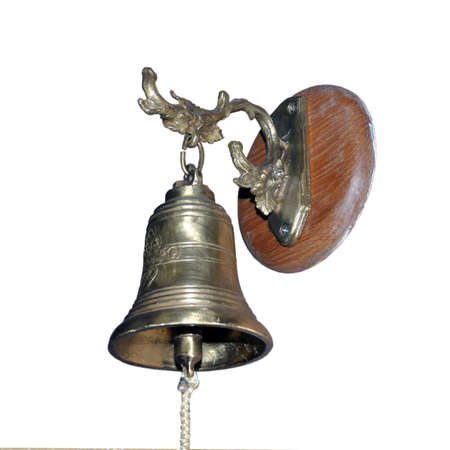 Old bell on a wooden wall, home decor. Isolated on a white background.