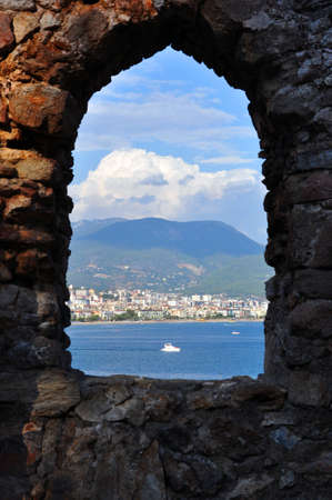 View of the Mediterranean Sea from the window of an abandoned ancient castle, Alanya, Turkey. Recreation Reklamní fotografie