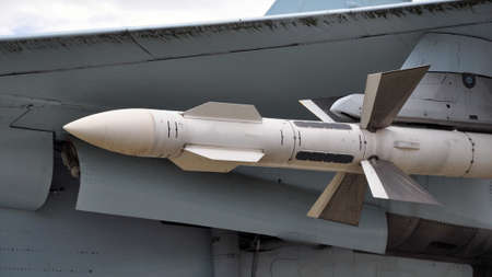 An air-to-air missile under an airplane wing. Military 스톡 콘텐츠