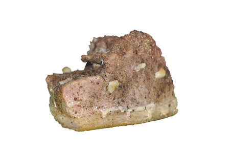 A piece of delicious, juicy and aromatic baked meat with seasonings. Isolate on white background Zdjęcie Seryjne - 134805439