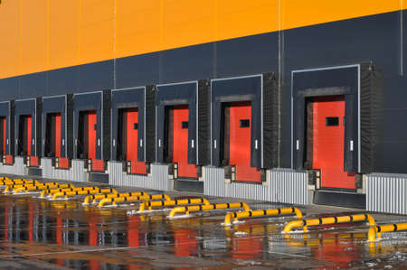 Front view of loading docks of a modern logistics center. Stock fotó