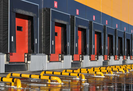 Front view of loading docks of a modern logistics center.