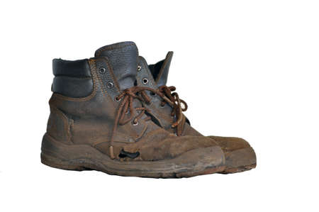 old work boots with a hole isolated on a white background. Archivio Fotografico