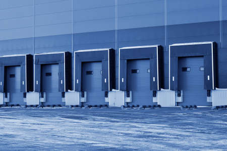 Front view of loading docks of a modern logistics center. Logistics. classic blue color