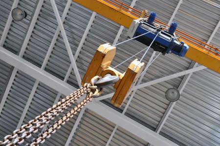 Chain Hoist. Industrial hook hanging on reel chain. Industrial