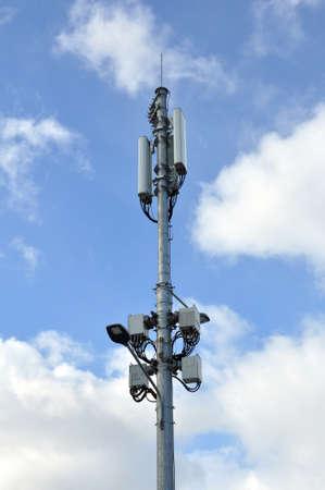 Base station of mobile cellular against the blue sky. Technology. Stockfoto