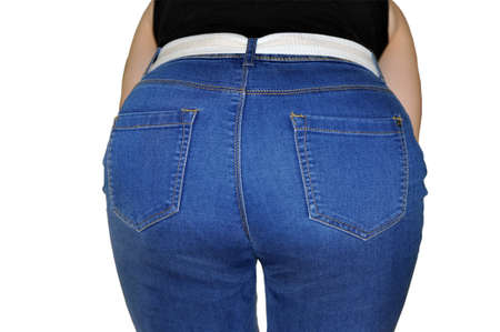 Sexy in jeans, clothes in pants. Sexy woman wearing of jean pants from back. Woman wearing of jean pants from back. Female bottom in tight jeans