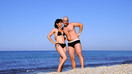 Man and woman alone on a deserted sea beach. Romatika and love.