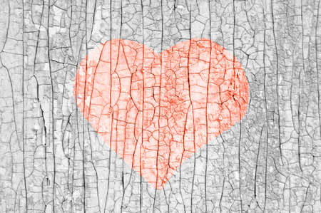 old heart drawing on old wooden wall. A symbol of past love.