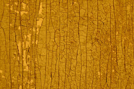 old wooden surface with cracked paint. Background, texture