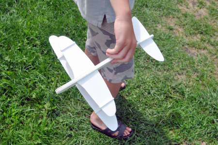 Toy plane in the sky. Game in the open air. Aviation
