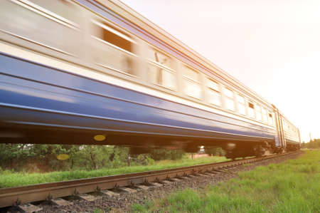 A high-speed diesel train moves quickly by rail. Blur, out of focus 版權商用圖片