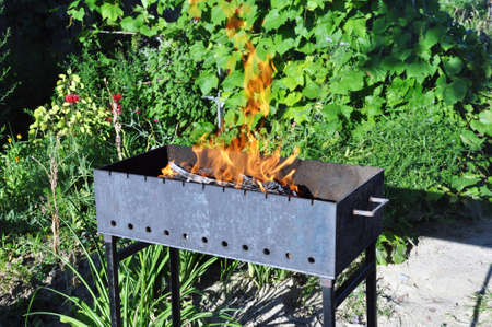 Brazier with burning charcoal for cooking kebabs, grilling. Fire, flame
