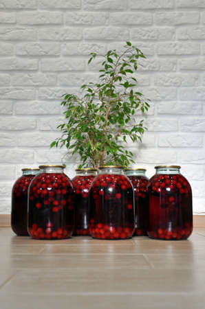 Tinned fresh cherry compote in a three-liter glass jar. Home canning.