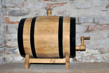 Wooden barrel for aging alcoholic beverages in a wine cellar 版權商用圖片