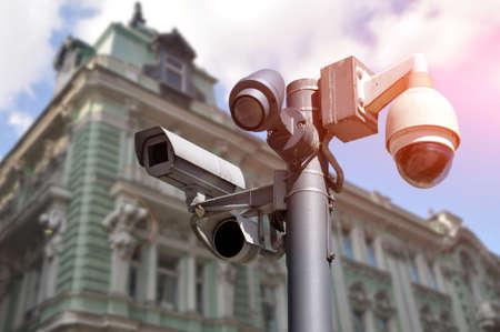 multidirectional CCTV camera installed on a city street. Safety Imagens