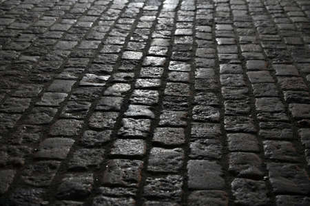 Granite paving stones on the pavement at night. Background