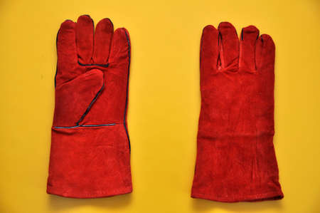Welders gloves on a yellow background. Protective accessory for welding.