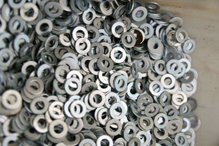 A set of mounting washers. Flat metal washer. Background.