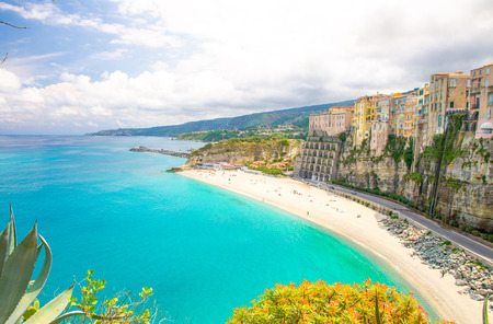 Tropea town and beach, Tyrrhenian Sea, colorful buildings on top of high big rocks, view from Sanctuary church of Santa Maria dell Isola, Vibo Valentia, Calabria, Southern Italy