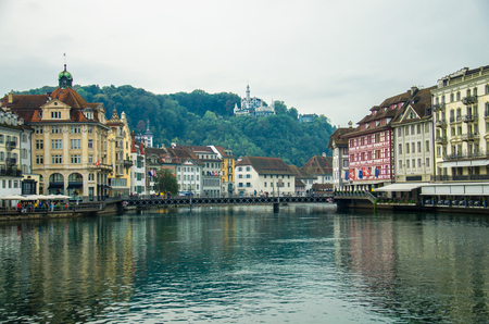 View of the historic city center of Luzern and Reuss river from famous wooden Chapel Bridge, oldest wooden covered bridge in Europe, Luzern, Switzerland