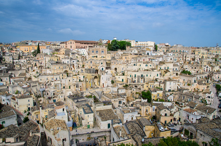 Matera panoramic view of historical centre Sasso Barisano of old ancient town Sassi di Matera with rock cave houses, European Capital of Culture, Basilicata, Southern Italy
