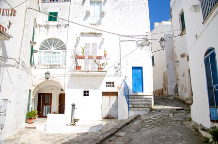Narrow streets of the town of Ostuni with white buildings in Puglia Apulia region, Southern Italy Stock Photo