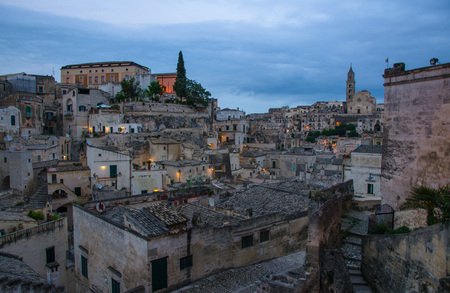 Matera evening panoramic view of historical centre Sasso Barisano old ancient town Sassi di Matera with rock houses, European Culture Capital, UNESCO World Heritage Site, Basilicata, Southern Italy