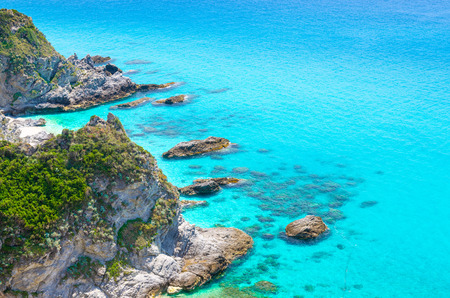 Rock and cliff of cape Capo Vaticano Ricadi aerial panoramic view from Parco Belvedere platform of green rock hill with amazing blue azure turquoise water of Tyrrhenian sea, Calabria, Southern Italy Stock Photo