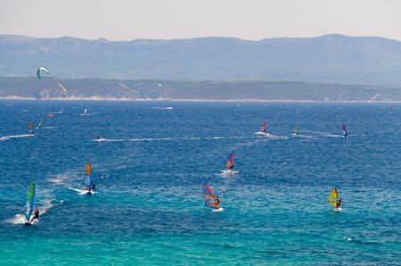 Windsurfers on water of Bol gulf Brac island in front of Hvar island, Adriatic sea, Croatia