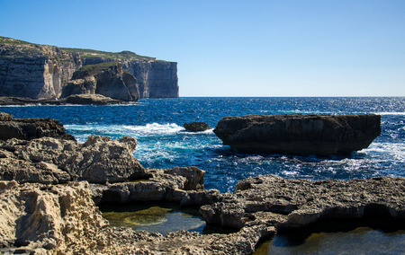 Amazing Fungus and Gebla Rock cliffs with Rocky coastline in the Dwejra Bay beach near collapsed Azure window, Gozo island, Malta