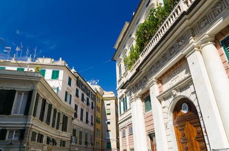 Facade of palace Palazzo Grimaldi della Meridiana classic style building with watch on doors on Piazza della Meridiana square in historical centre of old european city Genoa (Genova), Liguria, Italy