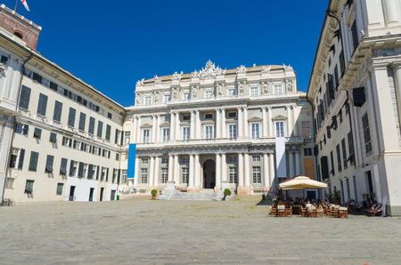 Doge's Palace Palazzo Ducale classic style building on Piazza Giacomo Matteotti square in historical centre of old european city Genoa (Genova) with blue sky background, Liguria, Italy
