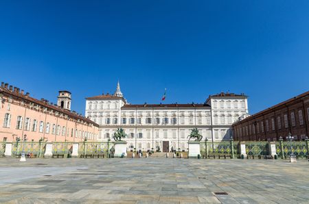 Royal Palace Palazzo Reale building on Castle Square Piazza Castello with fountains and monuments in historical centre of Turin Torino city with clear blue sky, Piedmont, Italy Stockfoto