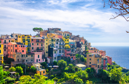 Corniglia traditional typical Italian village with colorful multicolored buildings houses on rock cliff and Genoa Gulf, Ligurian Sea background, National park Cinque Terre, La Spezia, Liguria, Italy Stock Photo - 118736161