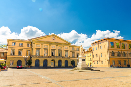 Teatro del Giglio theatre building and monument on Piazza del Giglio square in historical centre of medieval town Lucca in beautiful summer day with blue sky background, Tuscany, Italy