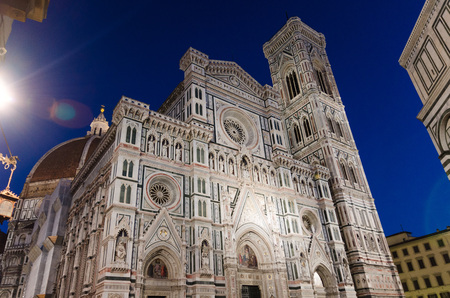 Florence Duomo beautiful marble facade, Cattedrale di Santa Maria del Fiore (Basilica of Saint Mary of the Flower Cathedral) on Piazza del Duomo square in the evening, at night, Tuscany, Italy