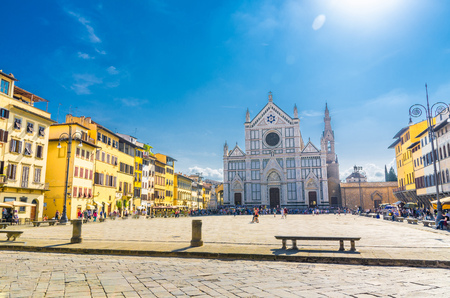 Basilica di Santa Croce di Firenze church and Calcio Storico Fiorentino (Piazza of traditional Florentine soccer) in historical centre of Florence city, blue sky white clouds, Tuscany, Italy 版權商用圖片